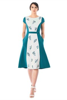 Our two-tone stretch-jersey knit dress with floral embellishment that offers a feminine touch while colorblocking visually streamlines your silhouette.
