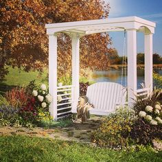 An off-the-shelf swing and repurposed deck railing make this #DIY arbor easier to build. Get the full instructions to make your own at Lowes.com/LCI-ArborSwing. #Lowes #Arbor #Garden #Inspiration