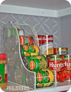 Small Kitchen Organizing Ideas • Tips, Ideas & Tutorials! Including this idea of using a magazine holder for storing your canned goods.