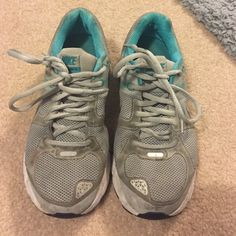 Nike size 7.5 running shoes Several years old. Gray and blue Nike running shoes. In okay condition. A few stains here and there. Still wearable, just needs some TLC! Nike Shoes Athletic Shoes