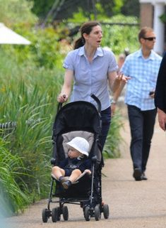Prince George is taken for a stroll by his nanny Maria Teresa Turrion Borrallo round Hyde Park pond, June Love this picture.
