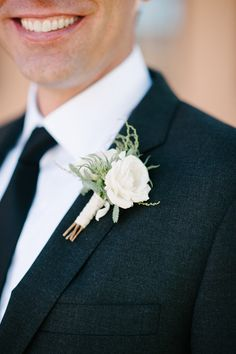 Simple white boutonniere | Photography: Acres Of Hope Photography - acresofhopephotography.com  Read More: http://www.stylemepretty.com/california-weddings/2014/05/01/rustic-italian-wedding-in-san-diego/