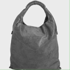 "Helmut Lang Neith Hobo Primal leather and suede unstructured hobo bag with braided leather short straps. Zippers at sides for expansion. Fabric lined interior with zipper pocket and slip pocket. 20"" height x 17"" width x 1"" depth. 7.5"" handle drop. Color: Sediment. Style: B09HA007 gently used. Very light blue markings on one side from rubbing on denim while being carried. Comes with dust bag. Price is firm, NO paypal or NO Trades. 10% Discount given on bundles only.  No Holds  PM EDITOR PICK…"