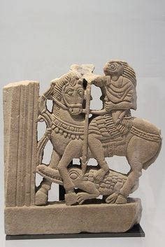 Faras, Soudan, circa 270-350 BC Part of a window decoration? The Egyptian god Horus as a Roman horseman slaying a crocodile. Sandstone - Louvre