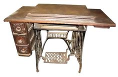 Antique sewing machine table with drawers & cast iron base