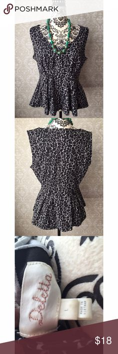 Deletta B&W peplum top Excellent used condition black and white Deletta peplum top. Classic colors and pattern, very versatile. Would be great under a jacket in cooler weather. Anthropologie Tops