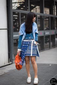Susie Lau of Style Bubble wearing Dior coat, Pero denim jacket, Sacai skirt, Coach clogs and Loewe 'Puzzle' bag after Sacai fashion show. Shop this look (or similar) here: Coat: Nº21 leaf print short sleeved coat // GIANLUCA CAPANNOLO cocoon pocket coat Jacket: A.P.C. ATELIER DE PRODUCTION ET