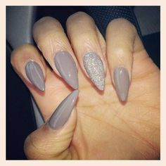 Grey stiletto nails with silver glitter accent