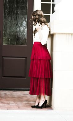 A modest tulle long maxi skirt with a ruffle tiered look and elastic waist that fits S-L available in black, wine, beige and grey