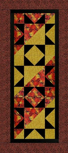 Quilting kit features packed Jack-O-Lanterns in shades of orange to red on a black background fabric, gold geometric and rust circles on black fabrics. There is a solid black for your inner borders. A