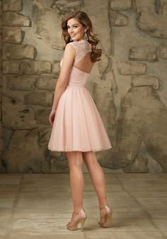 Feminine Lace and Tulle Bridesmaid Dress with Cap Sleeves and Keyhole Back Designed by Madeline Gardner. Satin Tie Sash. Zipper Back. Shown in Blush.
