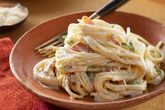 Twenty minutes is all you need for simply delicious carbonara. Cream cheese makes it, well, creamy; bacon, onion, Parm and zesty dressing add Italian restaurant-worthy flavor.
