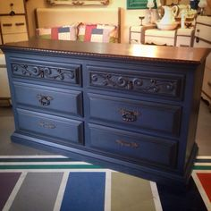 This is a recent commission piece that turned out nicely!! The top was stripped and sanded to bare, and resurfaced with Java Gel and Flat GF High Performance Top Coat. The base is painted with a custom mix of Chalk Paint® in Napoleonic Blue and Graphite for a deep navy that was sealed with clear wax followed by generous antiquing with dark wax.