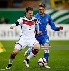 Nico Schulz of Germany is challenged by Domenico Berardi of Italy during the U21 International...