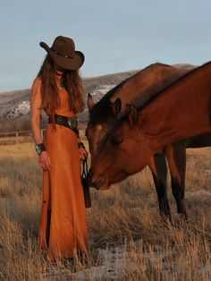 Cowgirl with a sack of horse smack