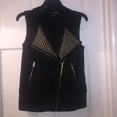 FOREVER 21 VEST WITH SILVER STUDS Great little go to vest from Forever 21. Silver studs on lapel. Zipper pockets. Black. Size Small. Length from shoulder to hem24 inches. Forever 21 Jackets & Coats Vests