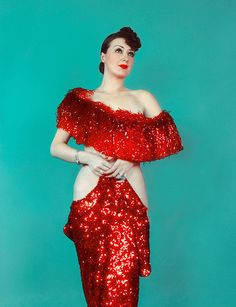 """""""Gypsy Rose Lee (January 9, 1911 – April 26, 1970) was an American burlesque entertainer famous for her striptease act. She was also an actress, author, and playwright whose 1957 memoir was made into the stage musical and film Gypsy."""" Source: Wikipedia"""