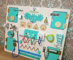 бизиборд от мастерской Смекалкин, развивающая доска, доска с замочками и лампочками. Для малышей 1-4 лет. Размер 60*50 см