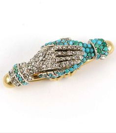 19th century turquoise and diamond cluster two-hands clasp, c.1835, with fittings for a single row necklace, modelled in clasped pose, or shaking hands, one set with rose cut diamonds, the other with turquoise, mounted in silver and gold  Length 3.2cm