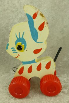 Vintage pull toy with red plastic wheels.