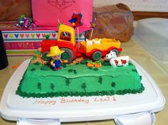 A homemade cake I made for my daughter's second birthday, using the Caillou Tracker set, can be bought online and at some Toys R Us stores.