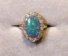 Black Opal and Diamond Oval Ring - this ring made my heart skip a beat #opalsaustralia