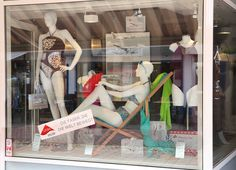 Exquisit Moden storefront in Nienburg/Weser, Germany, showcasing swimwear made with LYCRA® fiber. Take off with LYCRA® fiber!