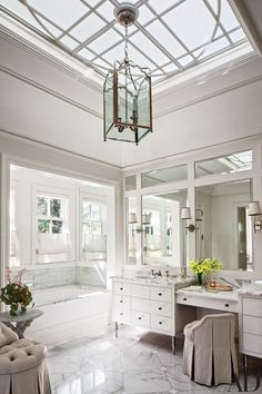 A Circa Lighting lantern and sconces grace the master bath | archdigest.com Visit architectoncoffee.com