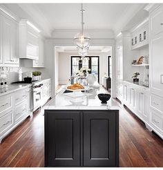 White cabinets, black island, black doors
