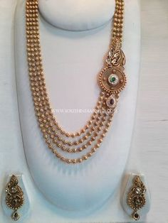 Multilayer Gold Ball Haram With Side LocketGold Plated Long Lakshmi Necklace with JhumkaGold Ball Haram With EarringsGold Long Lakshmi … Indian Wedding Jewelry, Bridal Jewelry, Indian Bridal, Gold Jewelry Simple, Silver Jewelry, Gold Jewellery Design, Jewelry Designer, Designer Wear, Fashion Jewelry