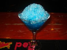 blueberry snow cone martini. original of mine....  For more cocktail pictures, follow the link and like the page.  Thanks https://www.facebook.com/pages/Damien-The-Intoxicologist-Filth/187108378032348?ref=hl
