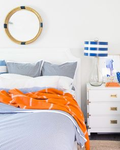 """""""A happy blue and white master bedroom with a perfectly fall-appropriate pop of persimmon."""