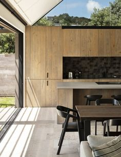 Sitting on fairly public site, this Waiheke Island holiday used clever design and thoughtful material choices to quietly slip from view Cedar Cladding, New Zealand Houses, Waiheke Island, Rural House, Timber Door, Solid Doors, Storey Homes, Big Windows, Clever Design