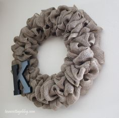 Burlap Wreath Tutorial...good tutorial.  This lady used fishing line stapled to the back of the letter and went through the garland to attach to the wire...it's clear so you couldn't see it.  Great idea!