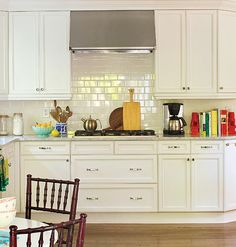 THE HANDLES ARE BORING AND DO NOTHING FOR THE KITCHEN  This North Carolina home's kitchen cabinets and backsplash allow the bold fabric choices in the breakfast area to shine.