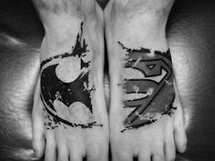 Batman and Superman tattoos.