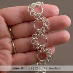 Wrap small bead in smal pattern as the jump rings to create links.    Silver Bracelet