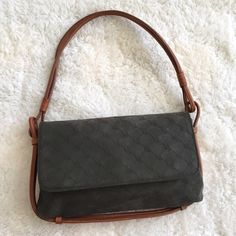 """Ralph Lauren Signature Suede & Leather Purse Pre-loved, in great condition! Suede olive green leather, brown leather strap detailing, main magnetic flap closure, small zippered inside compartment, dark green, monogrammed cloth lined. Measurements: 1.5"""" long X 6.5"""" tall X 2.5"""" wide. Ralph Lauren Bags Shoulder Bags"""