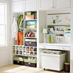 Integrated Entry Storage-This entry system doesn't leave organization to chance. Labels on hooks, baskets, and cubbies ensure that everything goes where it belongs. Closed upper cabinets store off-season gear, while boxes corral smaller items on open shelves. A bench seat opens for more storage capacity and slides neatly under the desk. At the desk, calendars and file bins keep paperwork and calendars organized