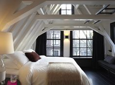 love the contrast of the black floor with the white and love how much light comes in through the windows