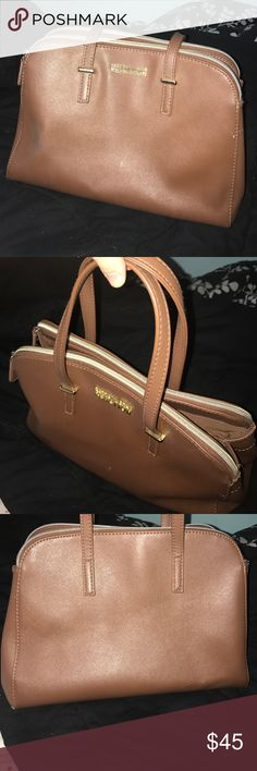 Kenneth Cole Reaction purse Used a few times. A nice saddle brown color with gold detailing. 3 pockets. Fits a lot of stuff. Kenneth Cole Reaction Bags Shoulder Bags