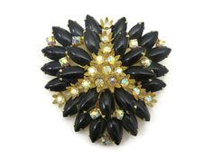 Hey, I found this really awesome Etsy listing at https://www.etsy.com/listing/231127688/costume-jewelry-rhinestone-brooch-black