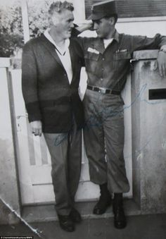 The scrapbook of Elvis, pictured with the compiler's father, is being sold after it was found by an auctioneer during a routine evaluation for a house sale in the Channel Islands