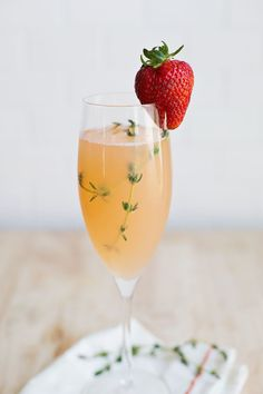 Strawberry Grapefruit Mimosa - fresh thyme and strawberries to garnish for extra fancy vibes.