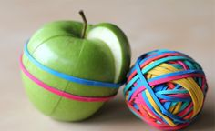 Simple solution to sending kids apples for snack: rubber band the sliced apple together - easy to grab and go.