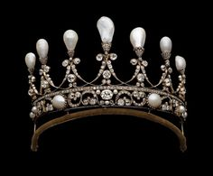 Gold and silver tiara, the openwork band at the base filled with pairs of diamonds set alternatively above and below between button pearls, except in the centre which is marked by a diamond between three small pearls. The seven pear pearls in diamond caps rise from addorsed diamond scrolls linked together like festoons, each enclosing a collet set diamond, resting on a channel set line of diamonds. German, Circa 1830