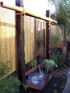 Water feature with beam and bamboo