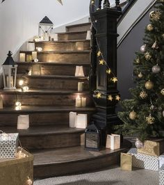 Bright Christmas decoration: lanterns and garlands for stairs