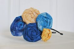 Hand rolled Rosette Headband in Shades of Blue and Yellow. $15.95, via Etsy.