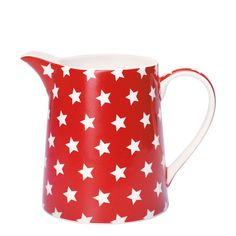 Red and white small jug from GreenGate. The Star Jug has a large curved body with a looped lifting handle and sizeable pouring spout. The crockery piece comes in a vibrant red finish with a gorgeous star pattern adorned in white across it, adding a muted and sophisticated contrast. Use your jug to house water at the dining table, milk for cereal or for orange juice first thing in the morning. Combine this piece with other key products from GreenGate to complete the look.